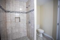 tile shower and toilet